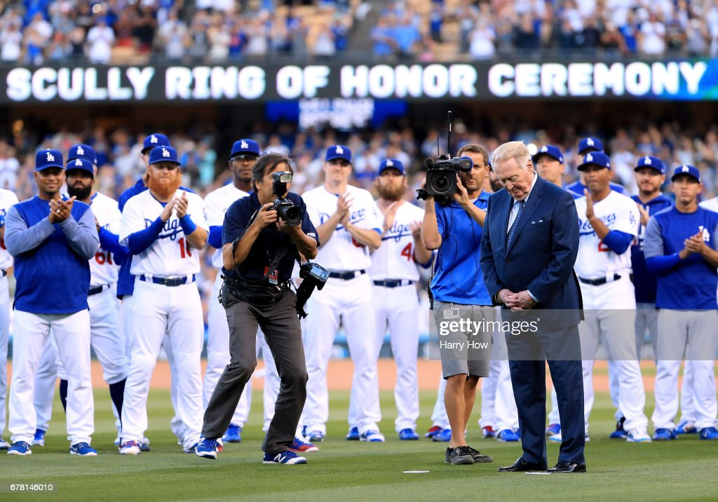 Former Los Angeles Dodgers announcer Vin Scully reacts as his plaque is unveiled during his induction into the Los Angeles Dodgers Ring of Honor at Dodger Stadium on May 3, 2017 in Los Angeles, California.