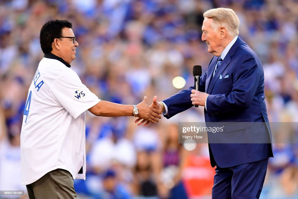 Former Los Angeles Dodgers broadcaster Vin Scully shakes hands with former Los Angeles Dodgers player Fernando Valenzuela before game two of the 2017 World Series between the Houston Astros and the Los Angeles Dodgers at Dodger Stadium on October 25, 2017 in Los Angeles, California.