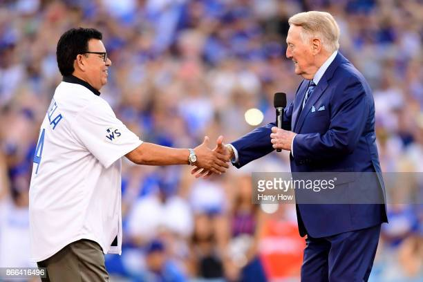 Former Los Angeles Dodgers broadcaster Vin Scully shakes hands with former Los Angeles Dodgers player Fernando Valenzuela before game two of the 2017...