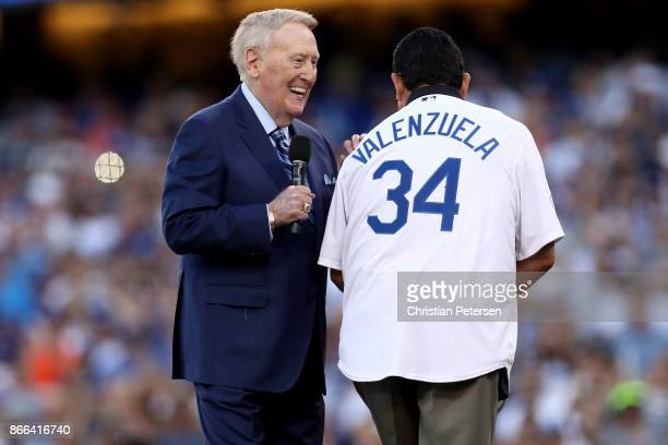 Former Los Angeles Dodgers broadcaster Vin Scully talks with former Los Angeles Dodgers player Fernando Valenzuela before game two of the 2017 World...