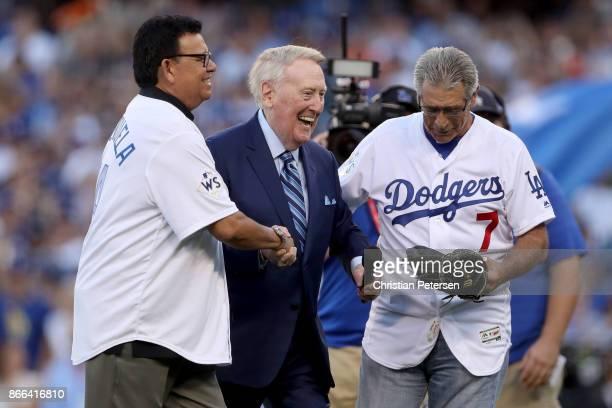Former Los Angeles Dodgers broadcaster Vin Scully talks with former Los Angeles Dodgers players Fernando Valenzuela and Steve Yeager before game two...