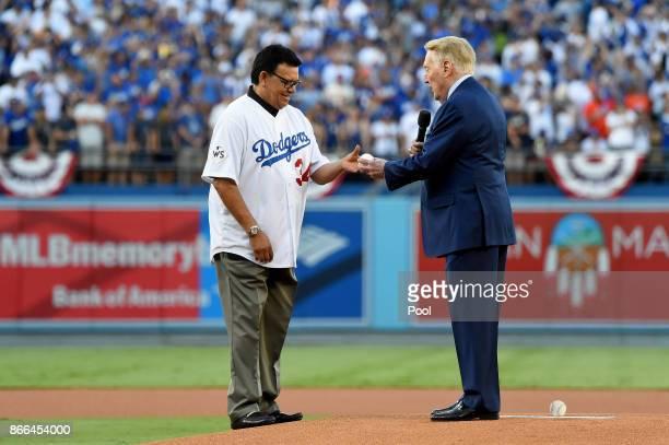Former Los Angeles Dodgers broadcaster Vin Scully talks with former Los Angeles Dodgers player Fernando Valenzuela prior to the ceremonial first...