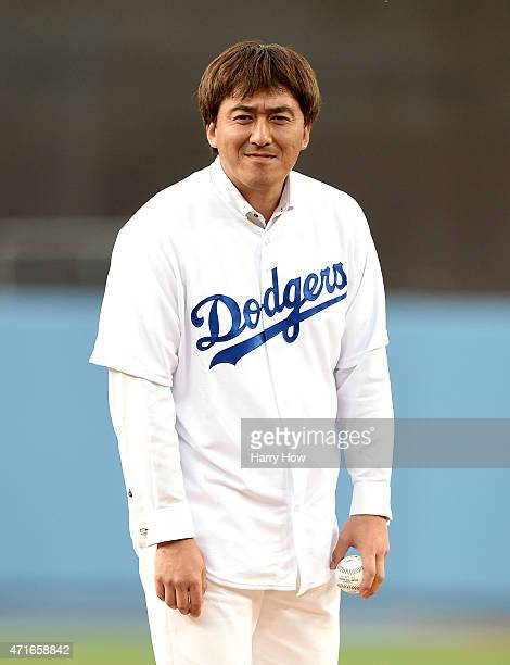 Former Los Angeles Dodgers Kazuhisa Ishii of Japan looks in before throwing a ceremonial first pitch before the game between the San Francisco Giants...