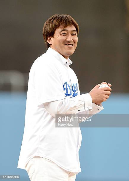 Former Los Angeles Dodgers Kazuhisa Ishii of Japan prepares to throw a ceremonial first pitch before the game between the San Francisco Giants and...