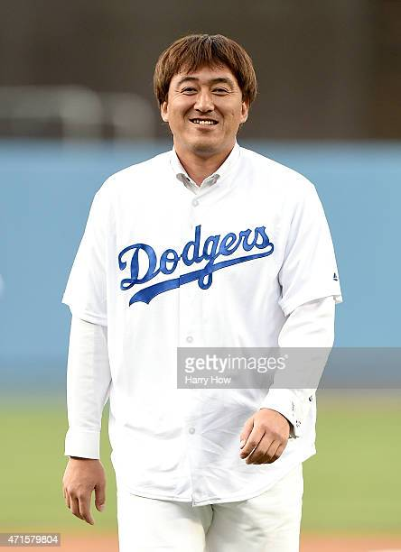 Former Los Angeles Dodgers Kazuhisa Ishii of Japan reacts after throwing a ceremonial first pitch before the game between the San Francisco Giants...