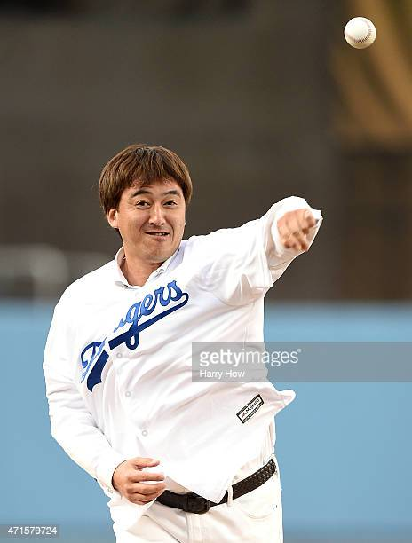 Former Los Angeles Dodgers Kazuhisa Ishii of Japan throws a ceremonial first pitch before the game between the San Francisco Giants and the Los...