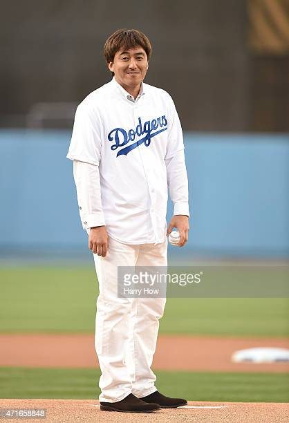 Former Los Angeles Dodgers Kazuhisa Ishii of Japan waits on the mound to throw a ceremonial first pitch before the game between the San Francisco...