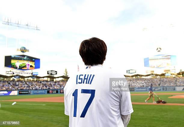 Former Los Angeles Dodgers Kazuhisa Ishii of Japan waits to throw a ceremonial first pitch before the game between the San Francisco Giants and the...