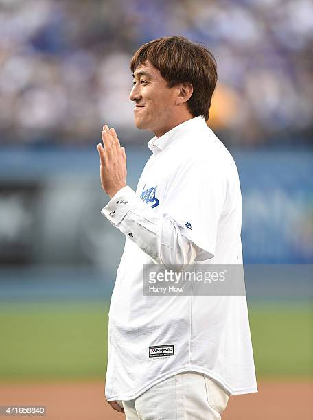Former Los Angeles Dodgers Kazuhisa Ishii of Japan waves as he is introduced to throw out a ceremonial first pitch before the game between the San...