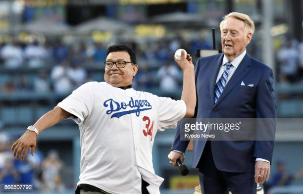 Former Los Angeles Dodgers pitcher Fernando Valenzuela throws out the ceremonial first pitch with former Dodgers broadcaster Vin Scully looking on...