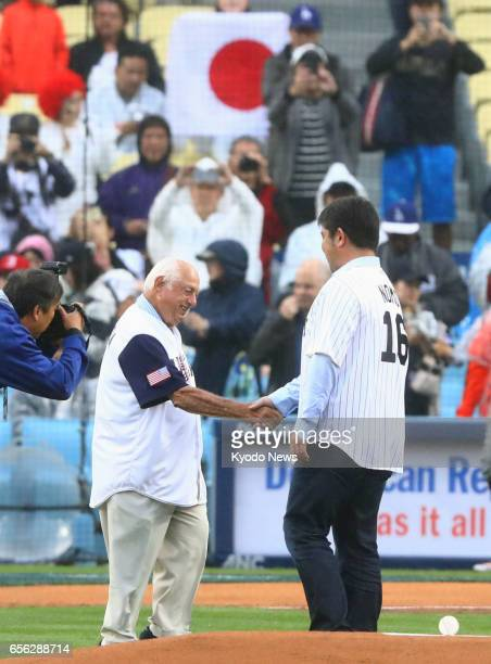 Former Los Angeles Dodgers pitcher Hideo Nomo shakes hands with former Dodgers manager Tommy Lasorda at Dodger Stadium on March 21 2017 Nomo threw...