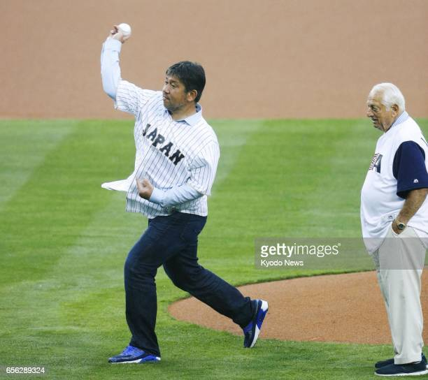 Former Los Angeles Dodgers pitcher Hideo Nomo throws out the ceremonial first pitch before a World Baseball Classic semifinal between Japan and the...