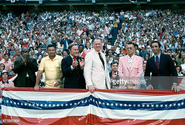 Former Los Angeles Dodgers pitcher Sandy Koufax far right is seen in the stands with Commissioner Bowie Kuhn center prior to the start of Major...