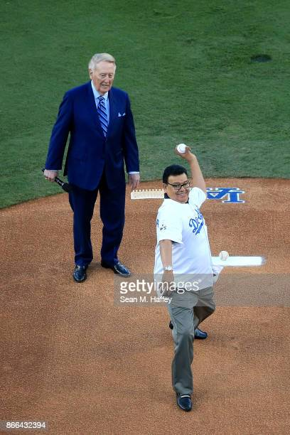 Former Los Angeles Dodgers player Fernando Valenzuela throws out the ceremonial first pitch as former Los Angeles Dodgers broadcaster Vin Scully...