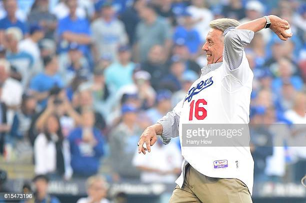 Former Los Angeles Dodgers Rick Monday throws out the ceremonial first pitch before game three of the National League Championship Series against the...