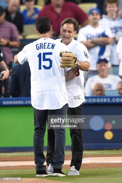 Former Los Angeles Dodgers Shawn Green and Eric Karros react after Shawn Green threw out the first pitch prior to Game Four of the National League...