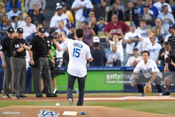 Former Los Angeles Dodgers Shawn Green throws out the first pitch to former Los Angeles Dodgers Eric Karros prior to Game Four of the National League...