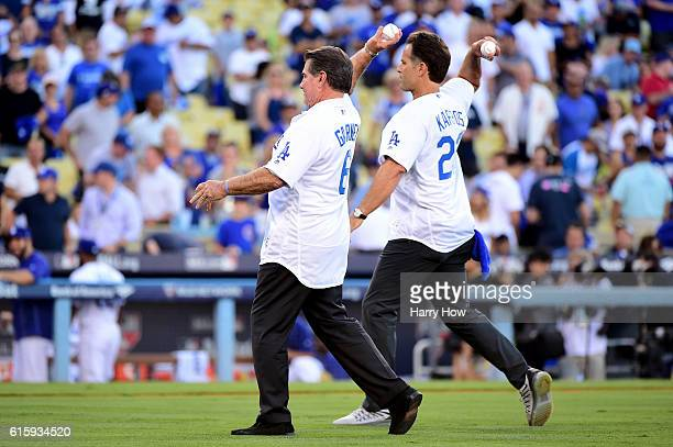 Former Los Angeles Dodgers Steve Garvey and Eric Karros make the ceremonial first pitch before game five of the National League Division Series at...