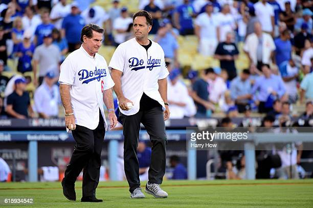 Former Los Angeles Dodgers Steve Garvey and Eric Karros walk to make the ceremonial first pitch before game five of the National League Division...
