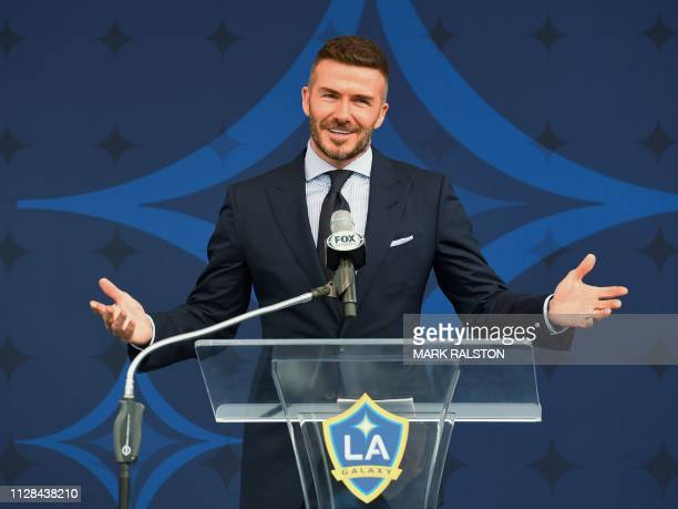 Former Los Angeles Galaxy midfielder David Beckham speaks at an event to unveil a new statue of him at the Legends Plaza in Carson, California on...