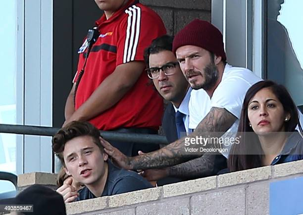 Former Los Angeles Galaxy players David Beckham Jovan Kirovsky and Beckham's son Brooklyn attend the MLS match between Philadelphia Union and the Los...