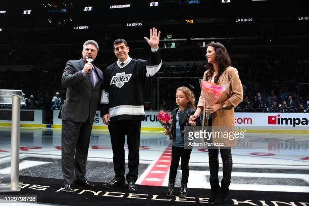 Former Los Angeles Kings defenseman Sean O'Donnell waves to the crowd while sanding with Kings broadcaster Nick Nickson and O'Donnell's wife Laura...