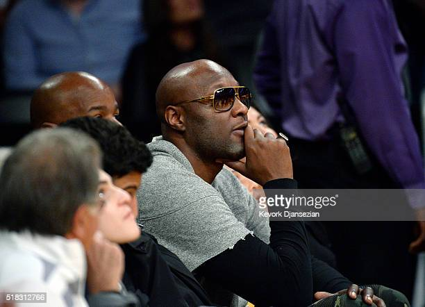 Former Los Angeles Lakers and Miami Heat basketball player Lamar Odom attends the basketball game between the Heat and the Lakers at Staples Center...
