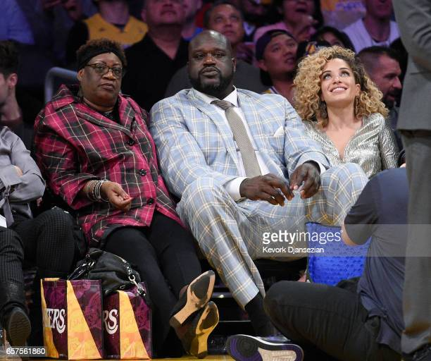 Former Los Angeles Lakers great Shaquille O'Neal his mother Lucille and girlfriend Laticia Rolle attend the Minnesota Timberwolves and Los Angeles...