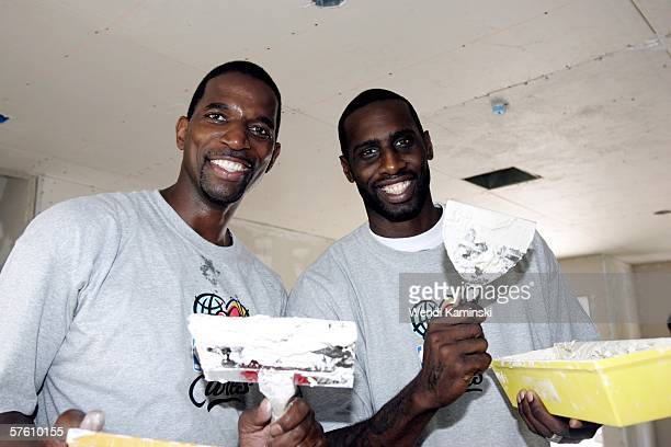 Former Los Angeles Lakers player AC Green and Tim Thomas of the Phoenix Suns work on Habitat Humanity's housing project for Maritza Jacobo's new home...