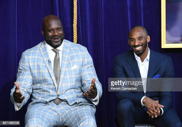Former Los Angeles Lakers player Shaquille O'Neal reacts to his former players seated in the audience with Kobe Bryant looking on during unveiling of...