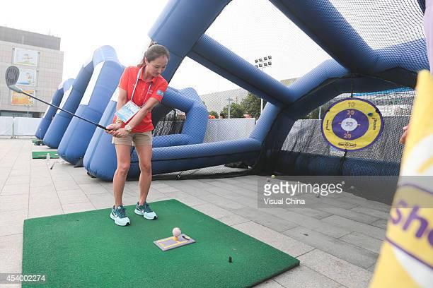 Former LPGA golfer Grace Park of South Korea demonstrates swing during IGF Sport Initiation Programme Activities at WANDA Celebration Site on August...