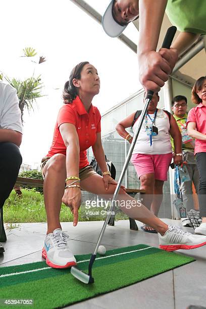 Former LPGA golfer Grace Park of South Korea instructs a student swing during IGF Sport Initiation Programme Activities at Nanjing Xuanwu Secondary...
