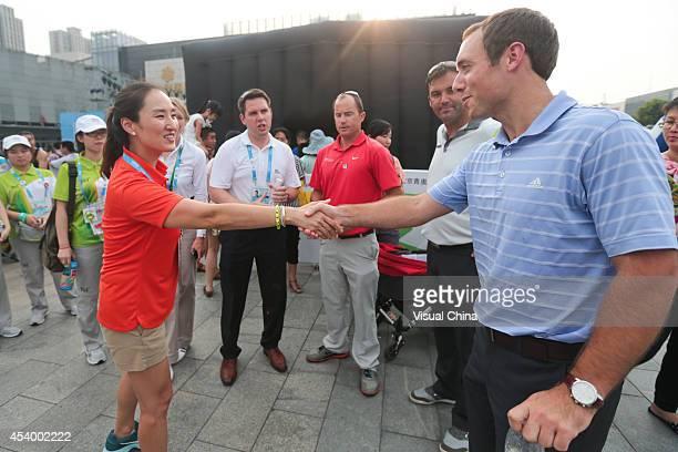 Former LPGA golfer Grace Park of South Korea shakes hands with Matthew Davis China¨CBritain Business Council International Development Manager during...