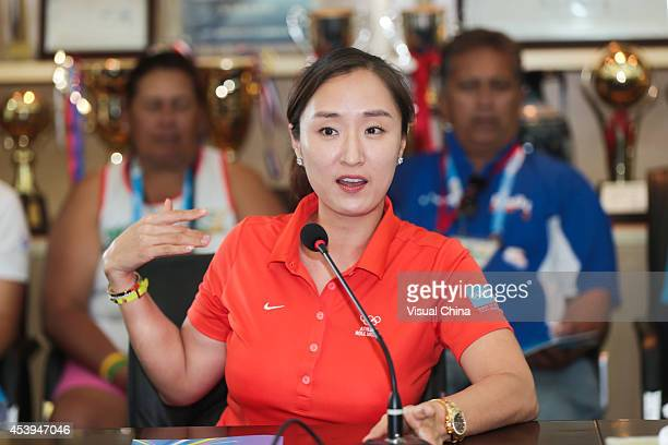 Former LPGA golfer Grace Park of South Korea speaks at a meeting during IGF Sport Initiation Programme Activities at Nanjing Xuanwu Secondary...