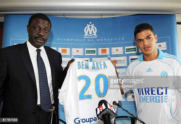 Former Lyon's France international midfielder Hatem Ben Arfa poses with his shirt with Olympique de Marseille's president Pape Diouf on July 2 2008...