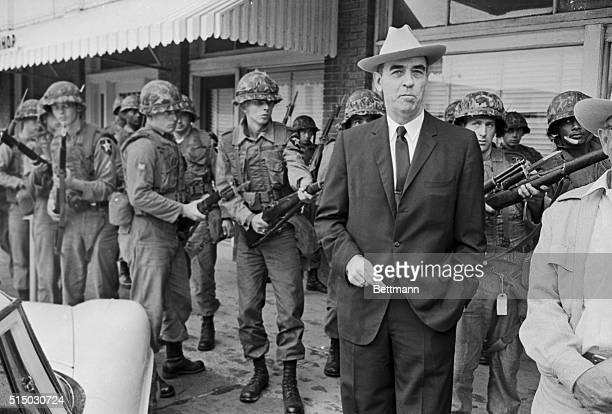 Former Major General Edwin A. Walker, who led U.S. Troops into Little Rock, Arkansas in 1957 to force integration at Central High School, is led away...