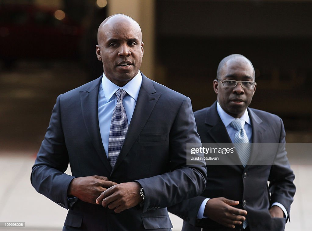 Former Major League Baseball player Barry Bonds (L) arrives for an arraignment hearing on March 1, 2011 in San Francisco, California. Barry Bonds and his former trainer Greg Anderson are appearing for an arraignment hearing ahead of a perjury trial that is expected to begin later in the month.
