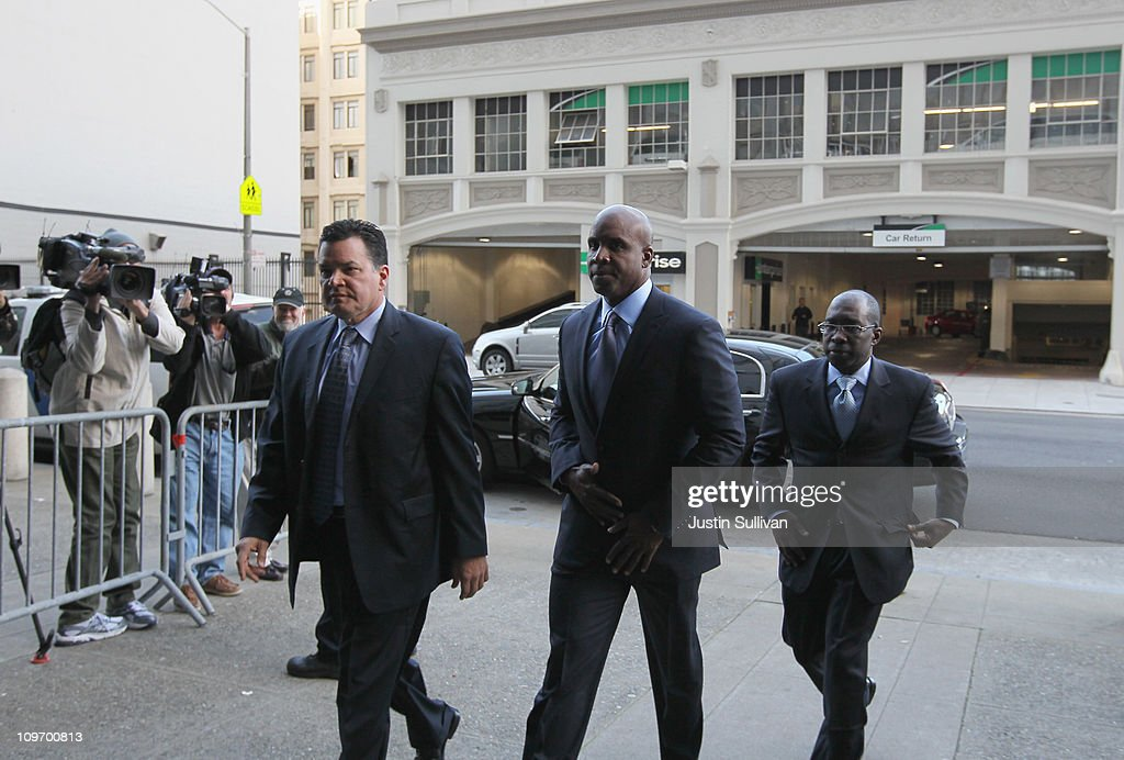 Former Major League Baseball player Barry Bonds (C) arrives for an arraignment hearing on March 1, 2011 in San Francisco, California. Barry Bonds and his former trainer Greg Anderson are appearing for an arraignment hearing ahead of a perjury trial that is expected to begin later in the month.