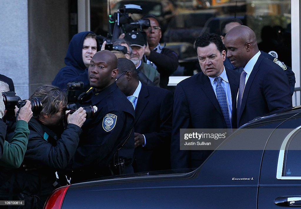 Former Major League Baseball player Barry Bonds (R) is escorted to his car after an arraignment hearing on March 1, 2011 in San Francisco, California. Barry Bonds and his former trainer Greg Anderson are appearing for an arraignment hearing ahead of a perjury trial that is expected to begin later in the month.