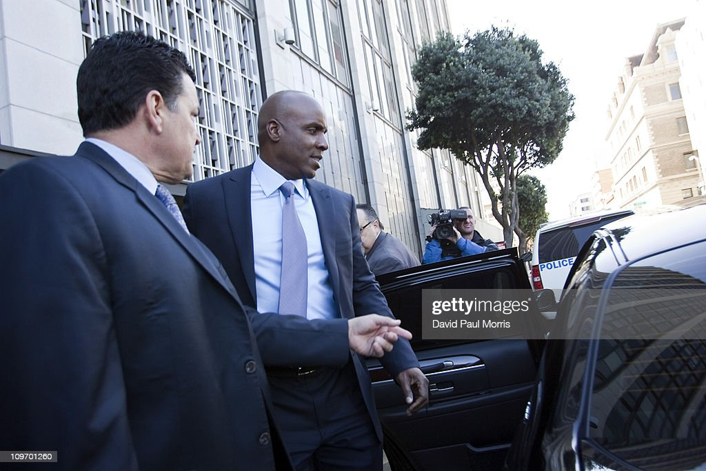 Former Major League Baseball player Barry Bonds (R) leaves the Phillip Burton Federal Building and United States Court House March 1, 2011 in San Francisco, California. Barry Bonds and his former trainer Greg Anderson are appearing for an arraignment hearing ahead of a perjury trial that is expected to begin later in the month.