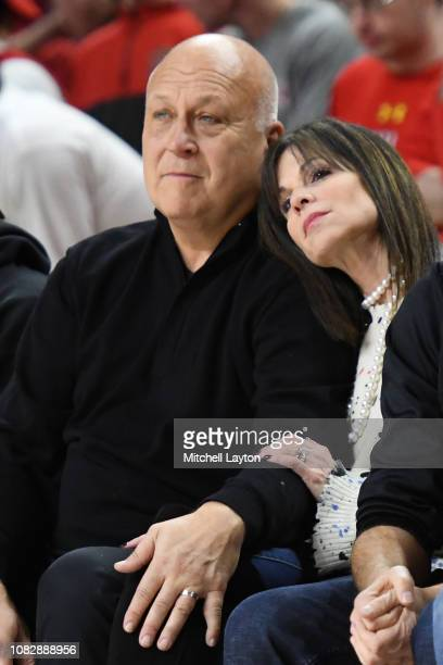 Former Major League Baseball player Cal Ripken Jr and his wife Laura Kiessling on the sidelines during a college basketball game between the...