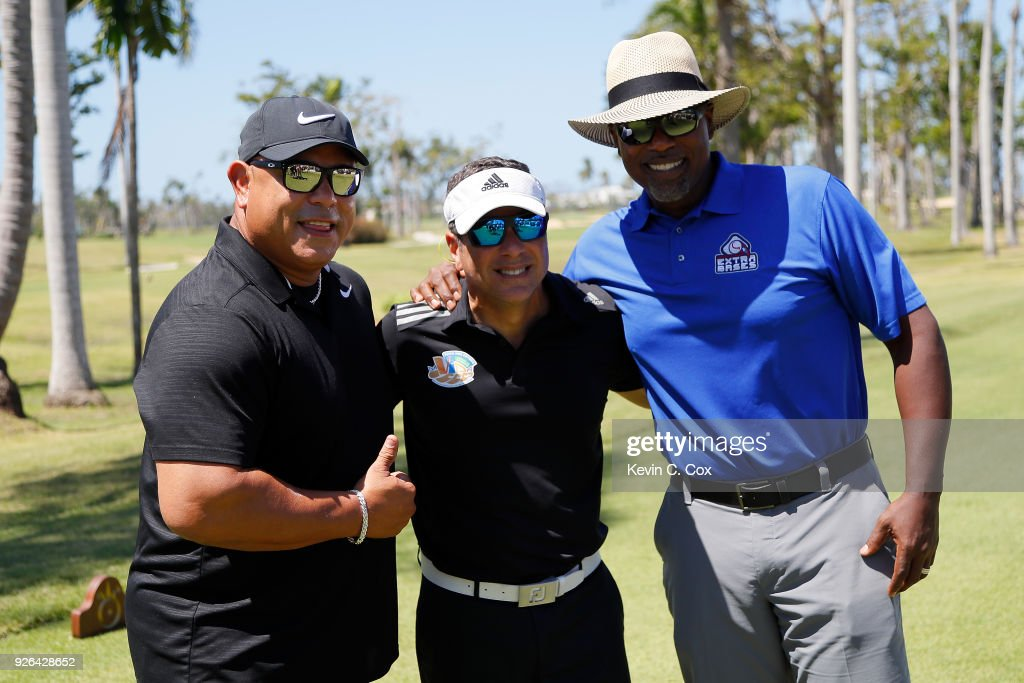 Former Major League Baseball player Carlos Baerga, actor and comedian Raymond Arrieta, and former Major League Baseball player Carlos Delgado pose for a photo opportunity on the eighth hole during the first day of the Puerto Rico Open Charity Pro-Am at TPC Dorado Beach on March 2, 2018 in Dorado, Puerto Rico.