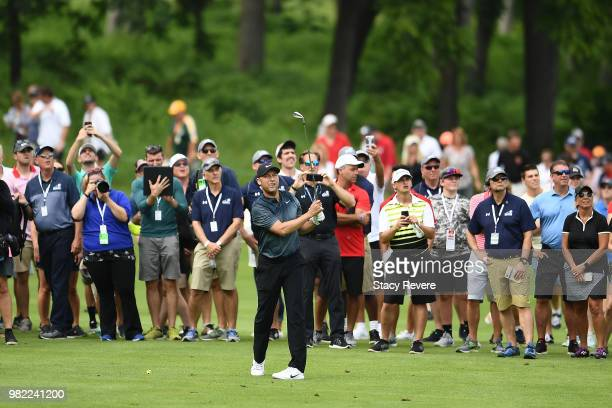 Former Major League Baseball player Derek Jeter hits his second shot on the 18th hole at the conclusion of the Celebrity Foursome during the second...