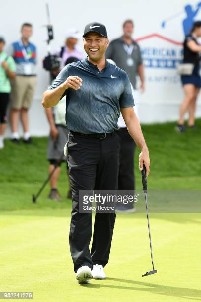 Former Major League Baseball player Derek Jeter walks across the 18th green at the conclusion of the Celebrity Foursome during the second round of...