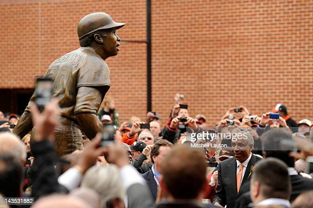 Former major league baseball player Frank Robinson watches the unveiling of his bronze sculpture before a baseball game between the Baltimore Orioles...