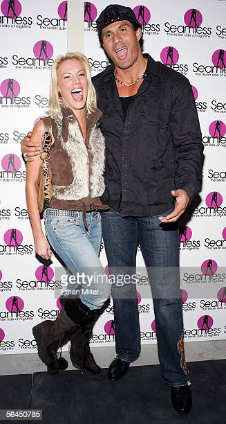 Former Major League Baseball player Jose Canseco jokes around with his friend Denise Pernula as they arrive at the grand opening of the Seamless...