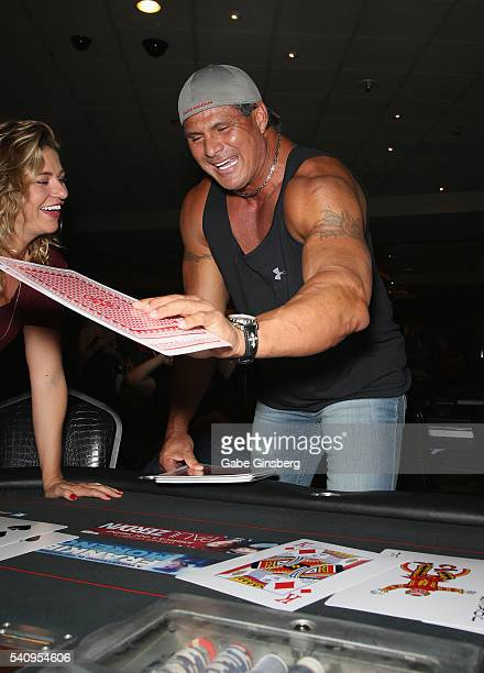 Former Major League Baseball player Jose Canseco plays with oversized cards during the Raising the Stakes Celebrity Charity Poker Tournament...