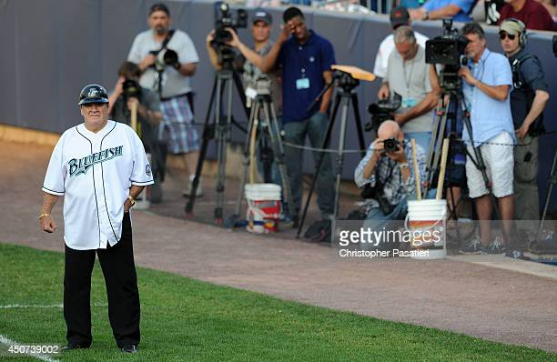 Former Major League Baseball player Pete Rose looks on from the first base coaches box while managing the game for the Bridgeport Bluefish against...