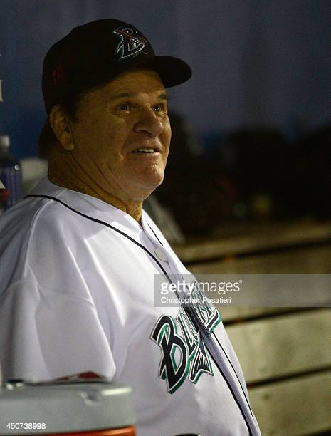 Former Major League Baseball player Pete Rose looks on from the dugout while managing the game for the Bridgeport Bluefish against the Lancaster...