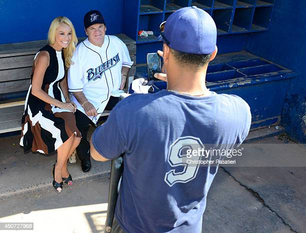 Former Major League Baseball player Pete Rose poses for a photo with ESPN reporter Britt McHenry after an interview prior to managing the game for...
